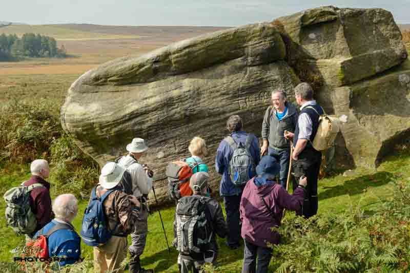 John Barnatt explains the role of the Buck Stone below Stanage Edge