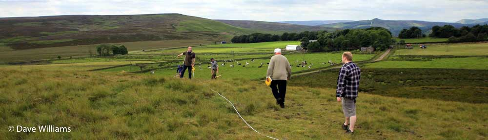 Surveying the site of a lead smelter on Peak District moorland near Sheffield. Photo © Dave Williams